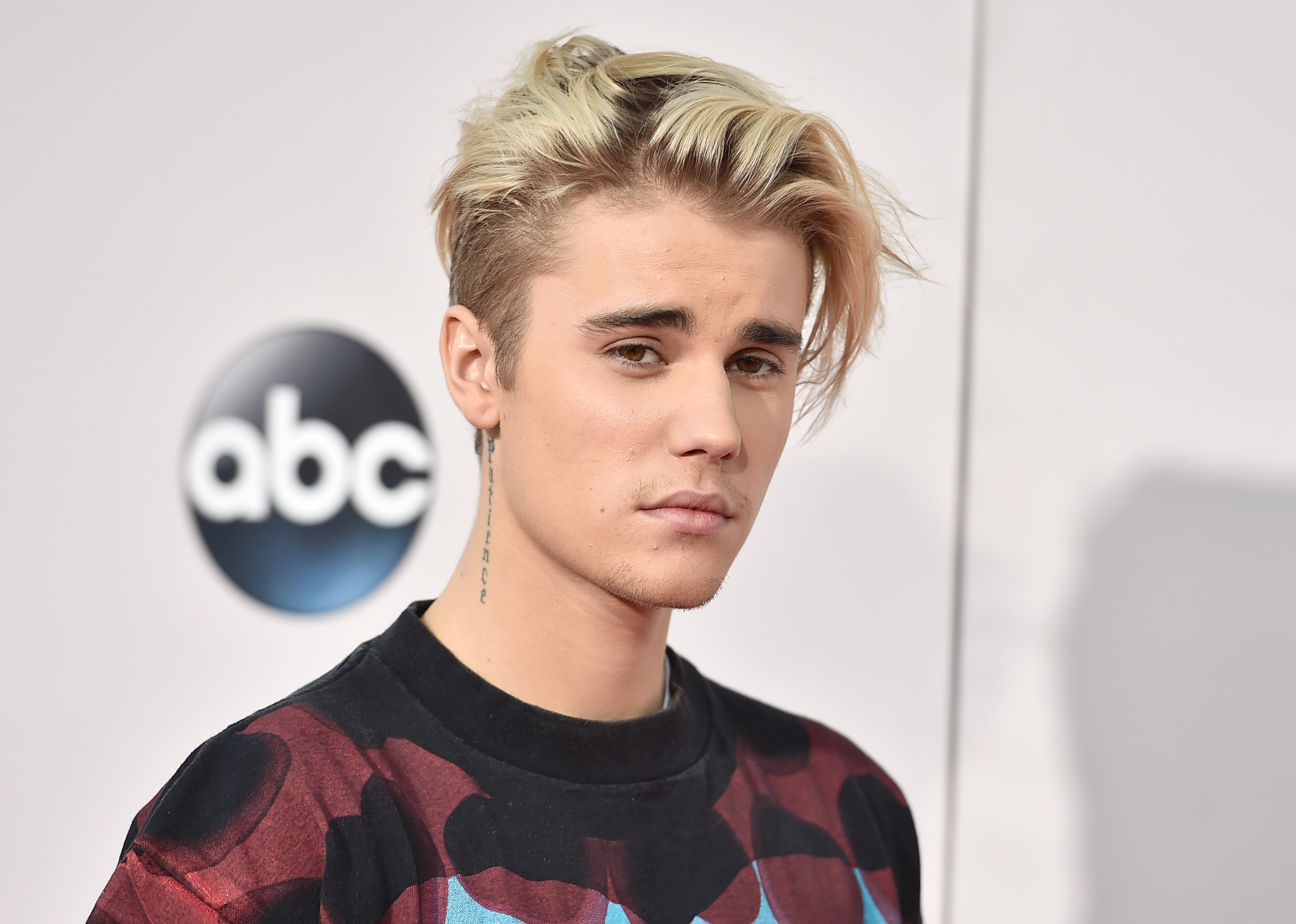 "FILE - In this Sunday, Nov. 22, 2015 file photo, Justin Bieber arrives at the American Music Awards at the Microsoft Theater in Los Angeles. With his recent batch of hit singles and semi-grown-up sound - including the electro-pop ""Where Are U Now"" with DJ-producers Skrillex and Diplo - adult men have begun attending the church of Bieber, and while some have issues admitting it, other proudly say they are Beliebers. ?Sorry? and ?What Do You Mean,? currently at Nos. 2 and 4 on Billboard?s Hot 100 chart, helped Bieber solidify his comeback after years of a broken image, which included arrests, public smoking and fainting onstage that led to hospitalization. (Photo by Jordan Strauss/Invision/AP, File)"