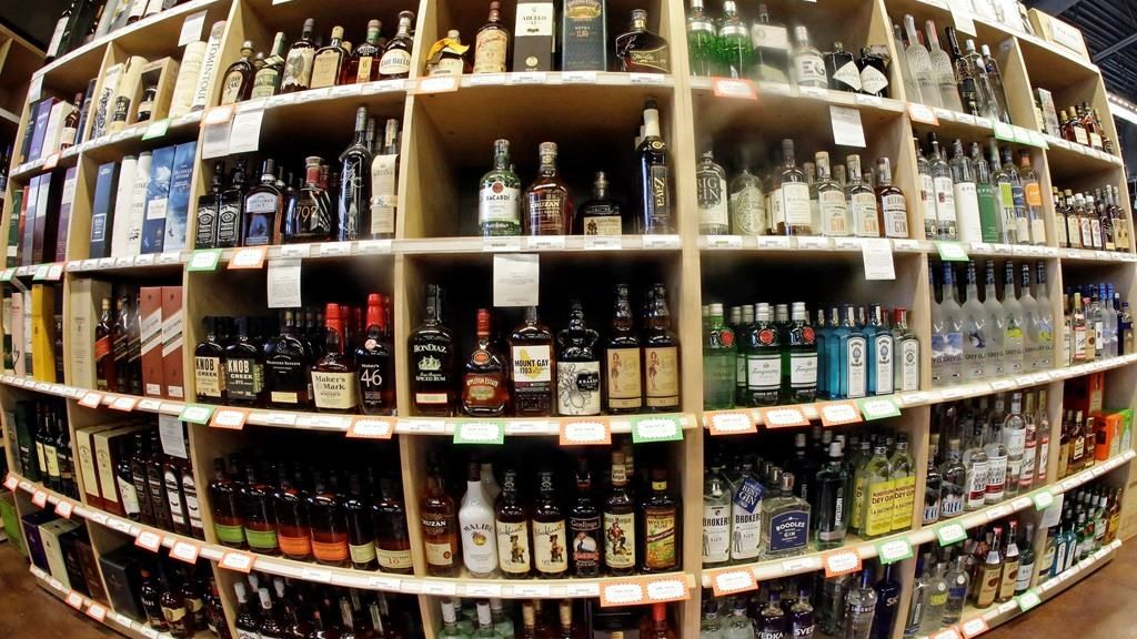FILE - This June 16, 2016 file photo made with a fisheye lens shows bottles of alcohol during a tour of a state liquor store in Salt Lake City. A large international study released on Thursday, April 12, 2018 says adults should average no more than one alcoholic drink per day, and that means many countries' alcohol consumption guidelines may be far too loose.