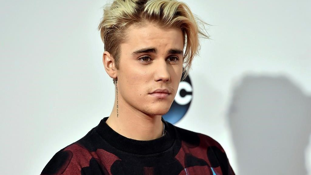 FILE - This Nov. 22, 2015 file photo shows Justin Bieber at the American Music Awards in Los Angeles. YouTube announced Thursday, May 2, 2019, that it is planning a project with the Grammy-winning Canadian pop star, set to premiere next year.