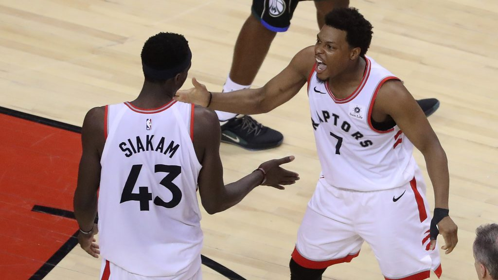 TORONTO, ON- MAY 25 - Toronto Raptors guard Kyle Lowry (7) encourages Toronto Raptors forward Pascal Siakam (43) after a play as the Toronto Raptors beat the Milwaukee Bucks in game six to win the NBA Eastern Conference Final in Toronto. May 25, 2019.