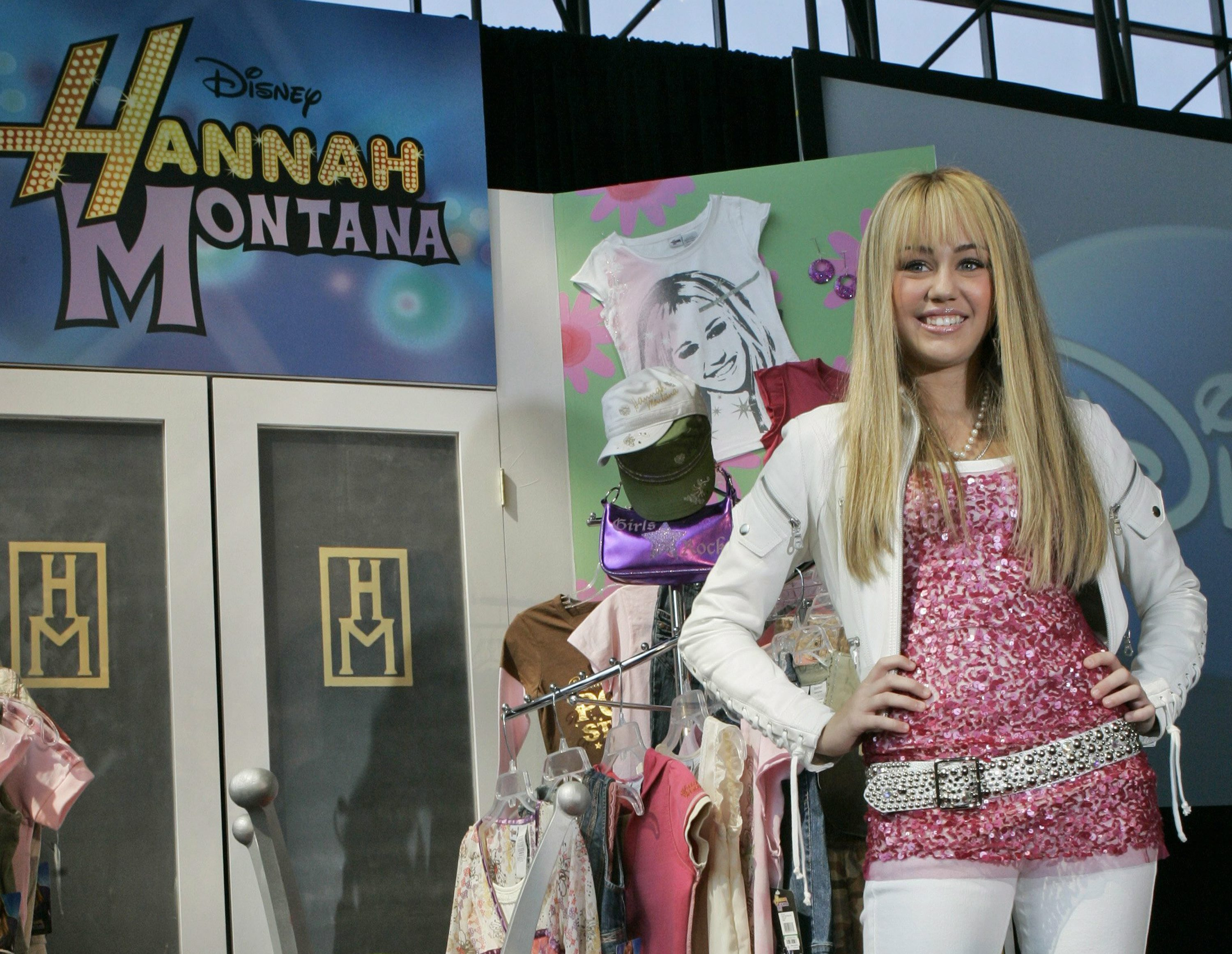 """FILE - In this June 19, 2007 file photo Miley Cyrus, star of The Disney Channel's series """"Hannah Montana"""" makes an appearance at the Licensing International Expo in New York. Costumes, props and tour items from the Disney Channel?Äôs ?ÄúHannah Montana?Äù TV series are going up for auction. The teen sitcom featured Cyrus, who portrayed schoolgirl Miley Stewart by day and international pop star Hannah Montana by night. It helped launched Cyrus?Äô career and the franchise included albums, films and concerts. Julien?Äôs Auctions announced on Thursday, April 11, 2019, all proceeds will benefit the Wilder Minds charity, which aids the world?Äôs at-risk animals."""