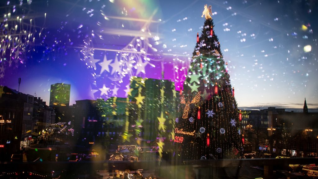 12 December 2019, North Rhine-Westphalia, Dortmund: According to the organizers, the largest Christmas tree in the world, which was built from about 1700 individual red spruces from the Sauerland region, stands at the Christmas market (photographed through a disc reflecting Christmas decorations). Photo: Bernd Thissen/dpa (Photo by Bernd Thissen/picture alliance via Getty Images)