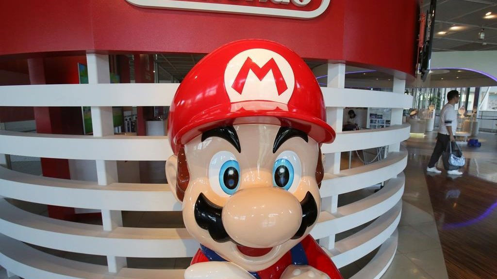 FILE - In this July 30, 2019, file photo, a Super Mario figure is displayed at a showroom in Tokyo. After months of being tight-lipped, Comcast executives on Thursday, Jan. 23, 2020, said the fourth park at Universal Orlando would be based on characters from Nintendo.
