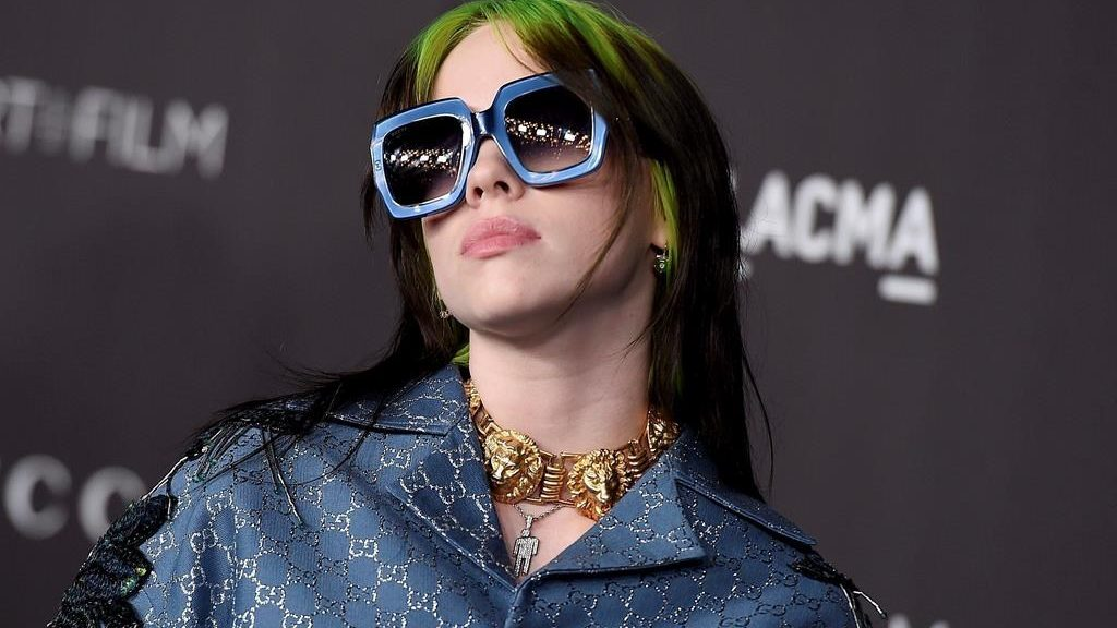 "FILE - This Nov. 2, 2019 file photo shows singer Billie Eilish at the 2019 LACMA Art and Film Gala in Los Angeles. Eilish is set to the sing the theme song for the upcoming James Bond film, becoming the youngest act to write and record a song for the iconic film franchise. Eilish, who turned 18 in December, recorded the song for the 25th Bond film, ""No Time to Die,"" which debuts in U.S. theaters on April 10."
