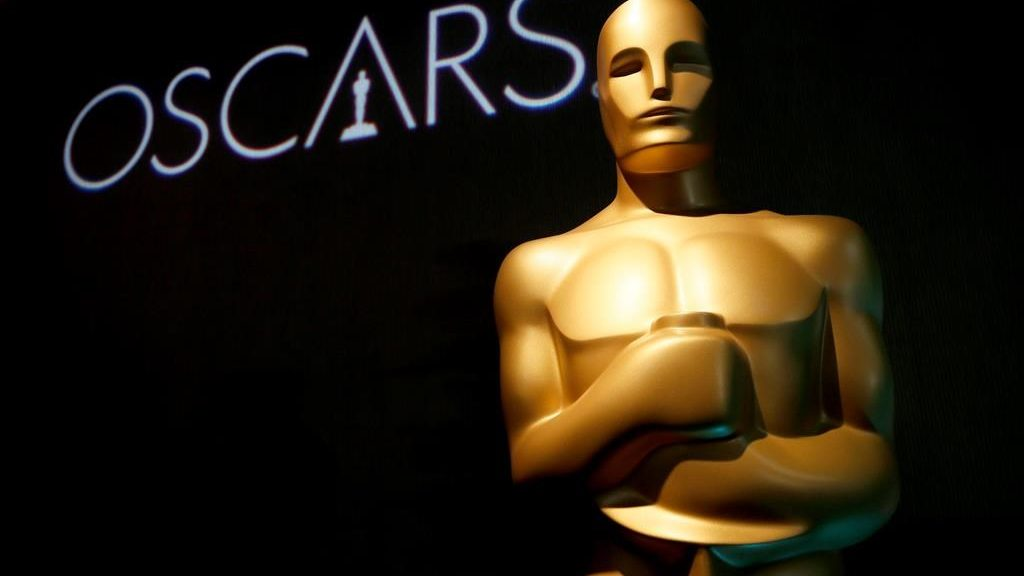 FILE - In this Feb. 4, 2019 file photo, an Oscar statue appears at the 91st Academy Awards Nominees Luncheon in Beverly Hills, Calif. The Oscars will not have a host for its annual awards show.