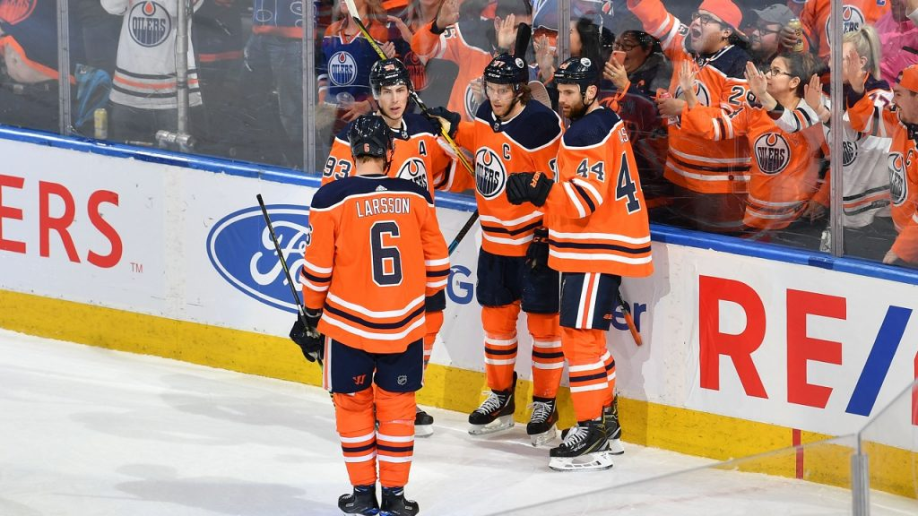 EDMONTON, AB - MARCH 7: Ryan Nugent-Hopkins #93, Adam Larsson #6, Connor McDavid #97 and Zack Kassian #44 of the Edmonton Oilers celebrate after a goal during the game against the Columbus Blue Jackets on March 7, 2020, at Rogers Place in Edmonton, Alberta, Canada. (Photo by Andy Devlin/NHLI via Getty Images)