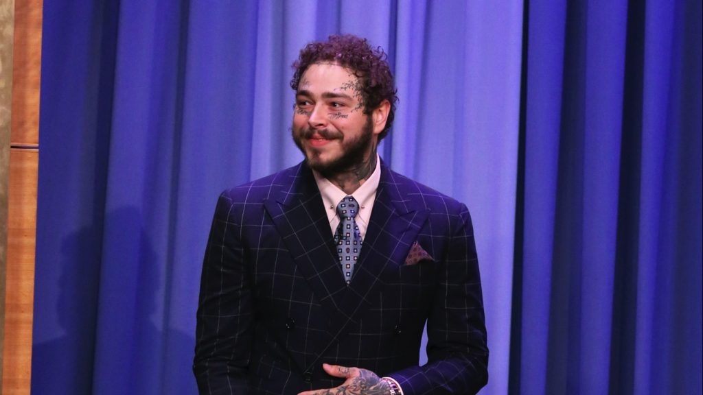 The Tonight Show Starring Jimmy Fallon - Season 6 THE TONIGHT SHOW STARRING JIMMY FALLON -- Episode 1103 -- Pictured: Rapper Post Malone arrives to the show on August 6, 2019 -- (Photo by: Andrew Lipovsky/NBCU Photo Bank/NBCUniversal via Getty Images via Getty Images)